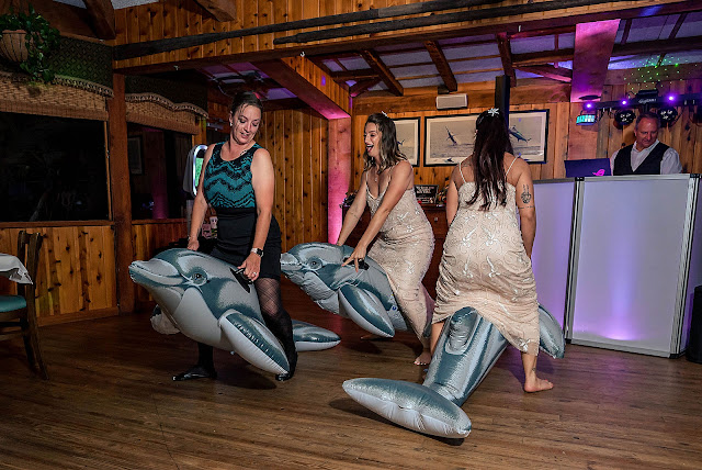 Guests dancing with dolphins at Reception
