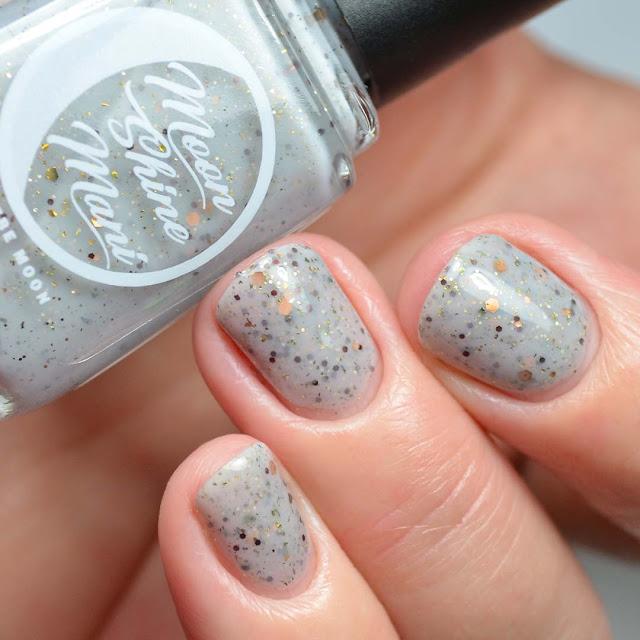 grey glitter nail polish swatch