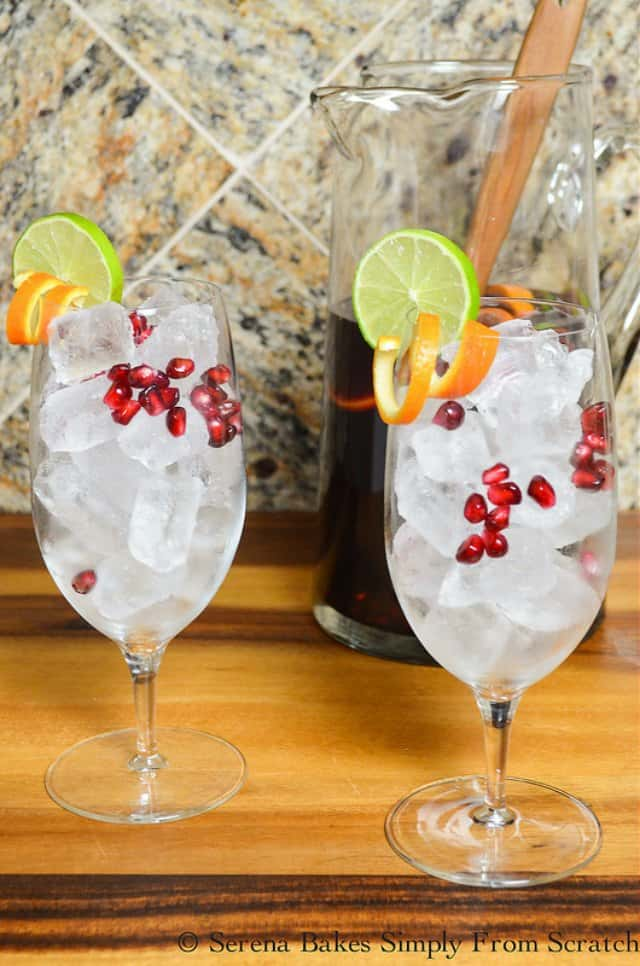 Glasses  filled with ice, and garnish with fresh Pomegranate Arils, Curled Orange Rind, and Lime Slices for Red Wine Sangria.
