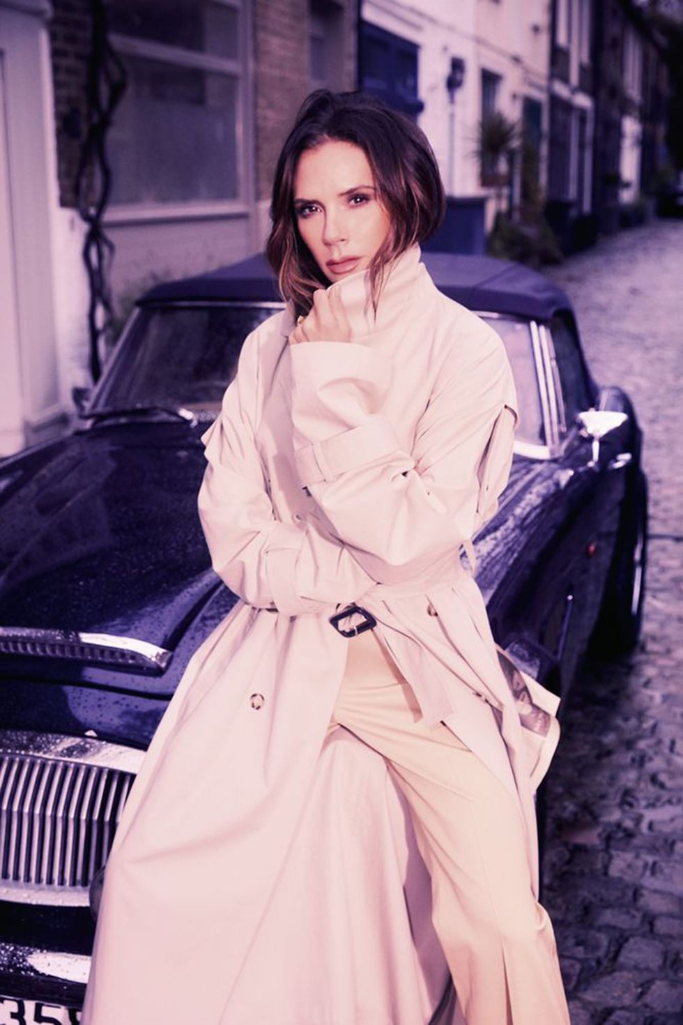 Trench coat and trousers both Victoria Beckham, jewellery Victoria's own