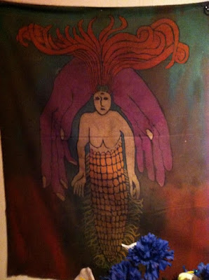 mermaid artwork at the voodoo museum of nola