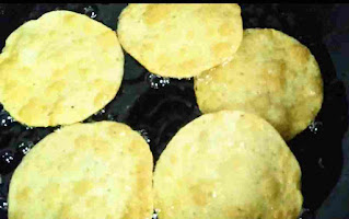 Deep frying four pakwan till crisp golden for dal pakwan recipe