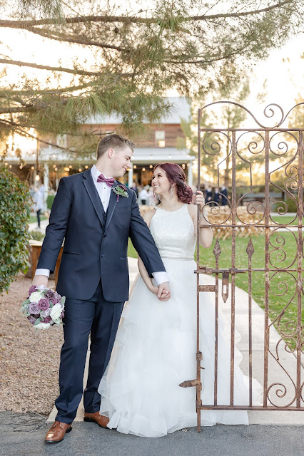 groom and bride with metal gate