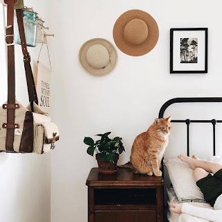 hat wall and minimalistic bedroom
