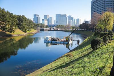 Sakurada Moat, Imperial Palace, Tokyo, Japan, with barge doing repair work.
