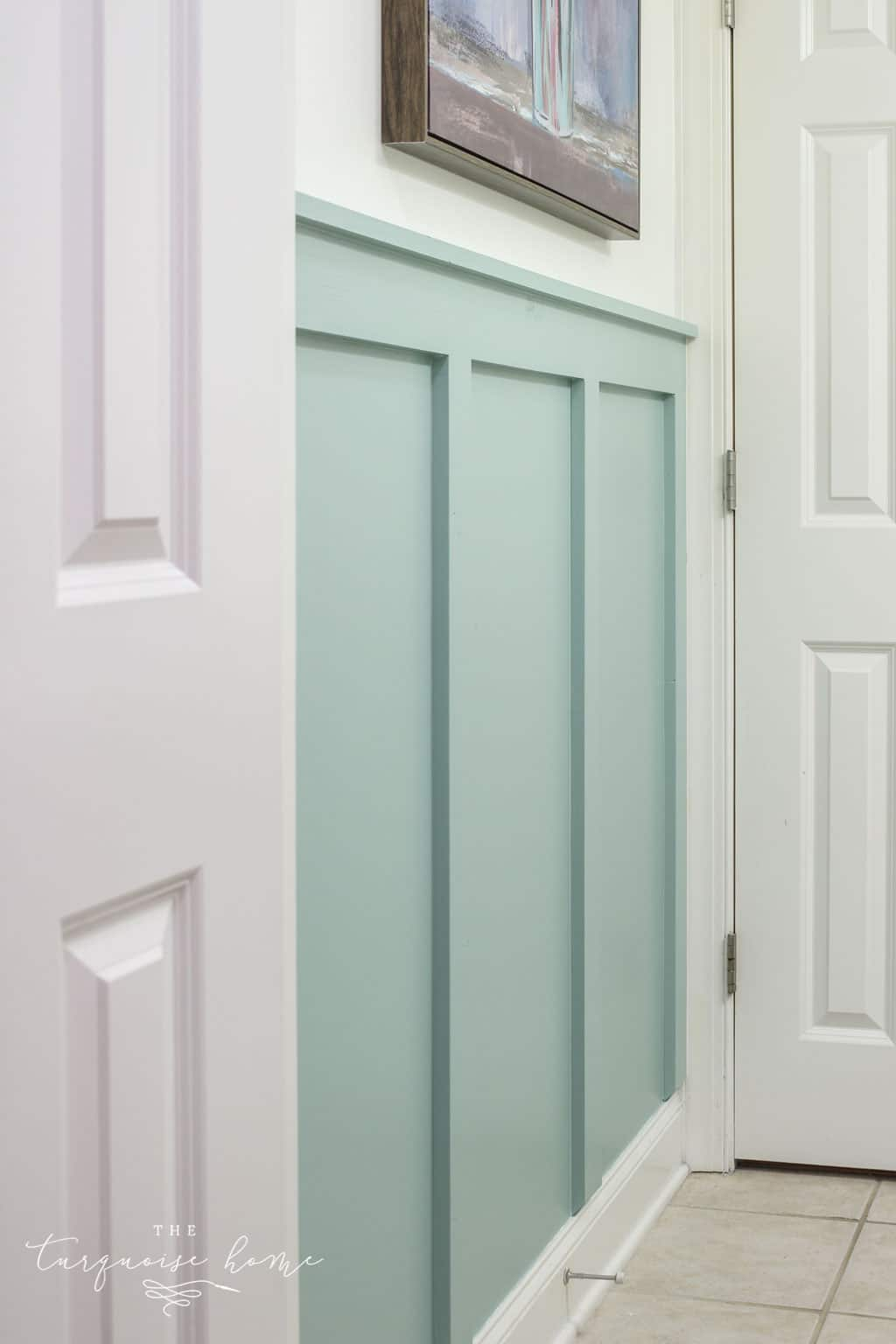 Mint color board and batten bathroom