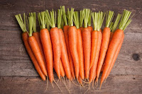 "Fresh bunch of carrots""/>"