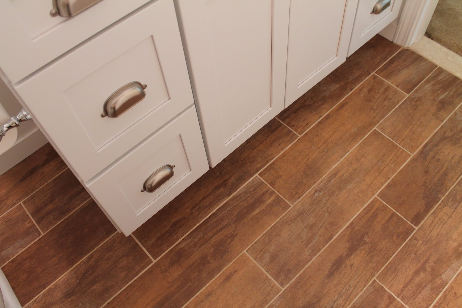 21 Woodgrain Tile Used In Bathroom Remodel, By Elizabeth And Co Featured On  @Remodelaholic