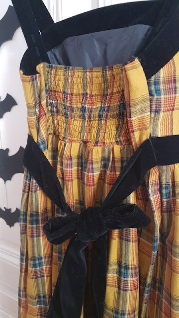 back side of a yellow plaid lolita dress with black velvet