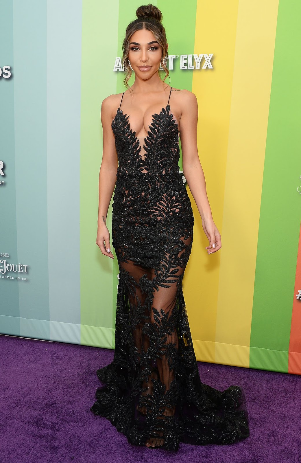 Chantel Jeffries flaunts her cleavage in glittering sheer black gown while walking the red carpet at amfAR gala
