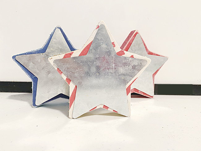 galvanized stars on wooden stars
