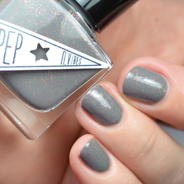 grey nail polish with flakies and shimmer