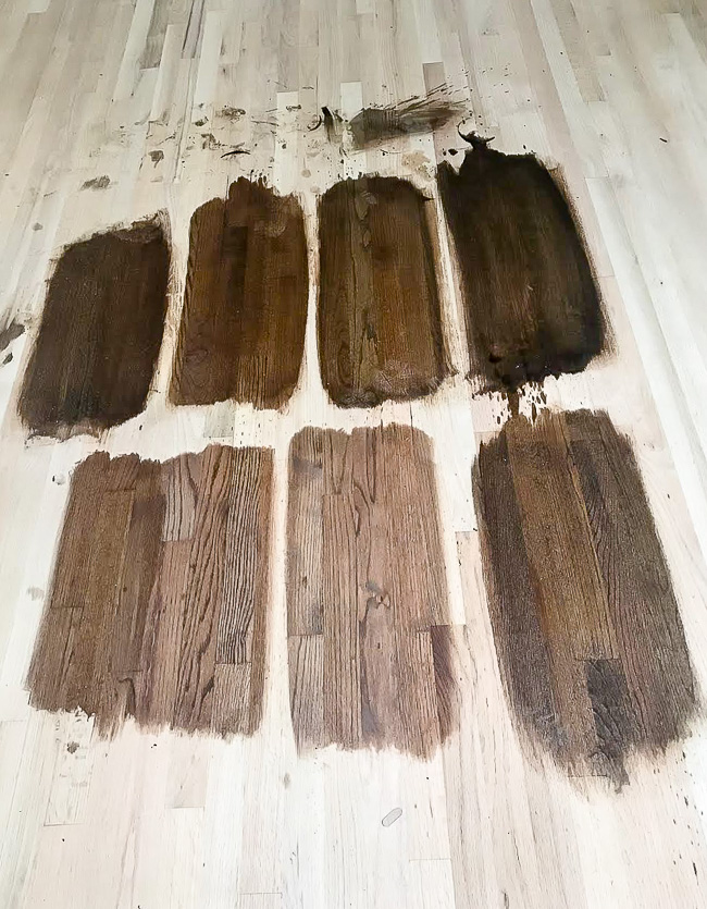 Testing Minwax stain samples on red oak hardwood floors