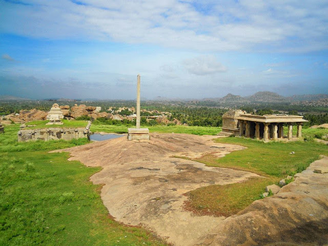 A Victory Pillar (Vijay Stambha) on Hemkuta Hill in Hampi