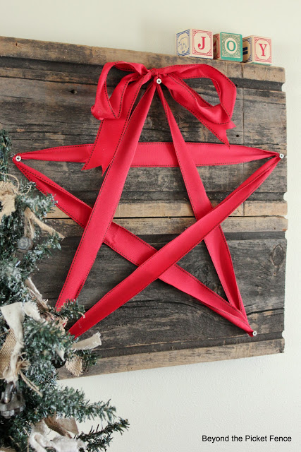 make a christmas star sign in less than an hour with reclaimed wood and ribbon