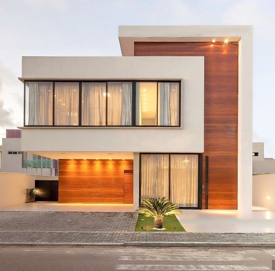 Do you want your house to be simple but attractive?  Simplicity is a beauty. Houses are attractive in many ways. But we will help you focus on the attractiveness of the house based on its color. We have chosen a lot of ideas and came up to focus on some Modern White Houses which are very common in our society today.  Modern White Houses are found anywhere. This type of houses might be at your neighborhood or across the street of your houses. These are also very useful especially when it comes to the exterior part as it provides more attractiveness and its impact on the viewers are commendable. It may look simple but on the other hand, it enhances its fashion and beauty. It also provides fresh and clean ambiance in one's home. It is also a good choice of color for those who want a simple but elegant background in their house.  Aside from the modern style of the house, the white exterior design also provides balance in its beauty and texture which will be more favorable in the eyes of those who will enter and visit. We have here a series of designs and ideas for your future Modern White Houses. Enjoy and look for the best design for your house.