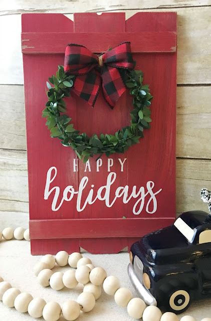 "Vintage Paint and more... Christmas Cheer transfer used on a ""faux""pallet board with a ""faux"" boxwood wreath and red and black buffalo plaid bow added"