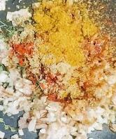 Mixing masala with onions for paneer tikka masala recipe