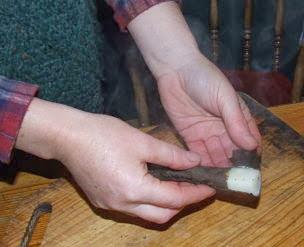 Scorzonera root being peeled