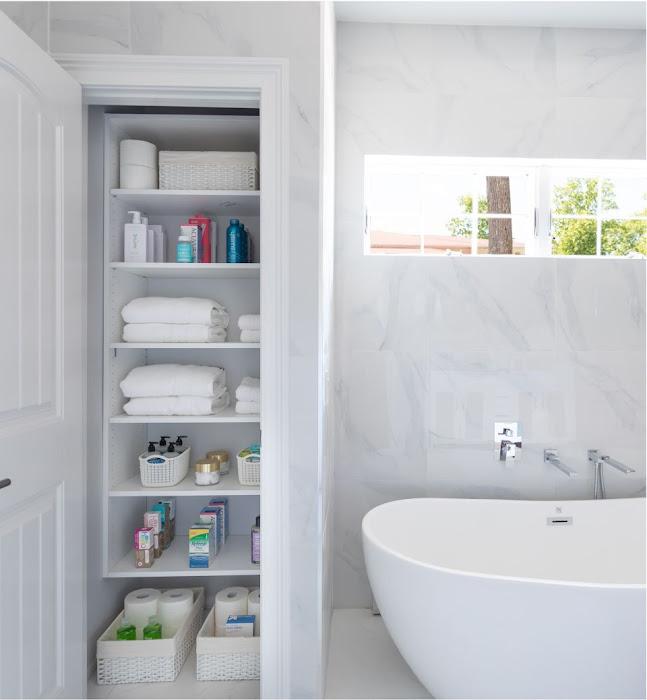 organized bathroom linen closet