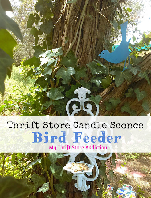 thrift store candle sconce bird feeder