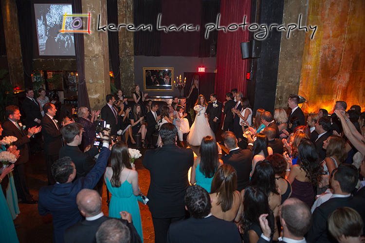 The Grand Entrance of the newlywed couple through the main floor of The Edison