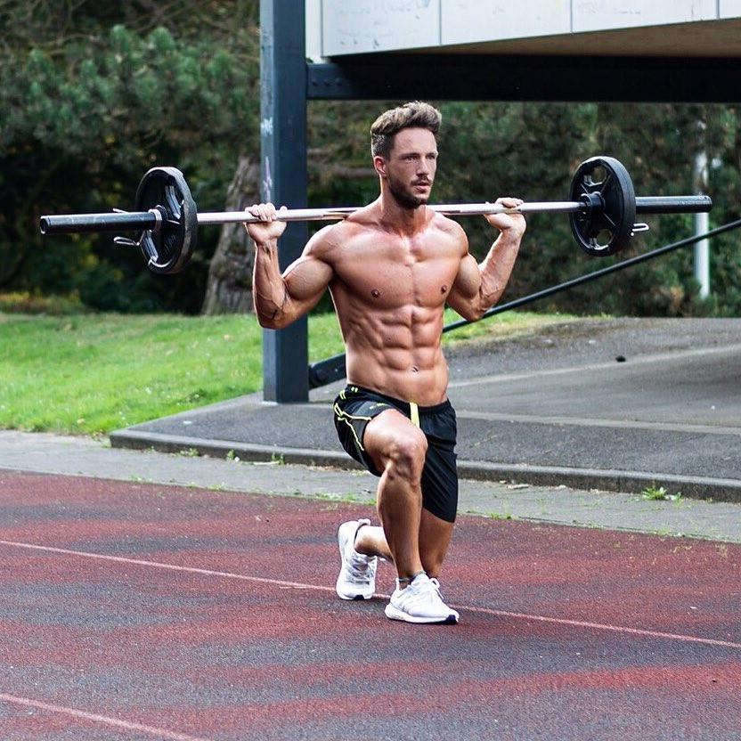 attractive-muscle-daddy-showing-off-shirtless-sixpack-abs-shredded-body-outdoors