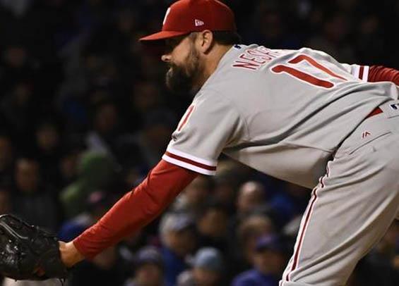 Philadelphia reliever Pat Neshek stumbles vs. Mets