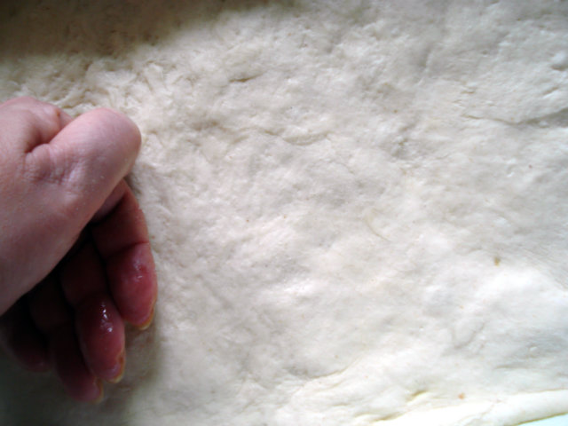 flatten the dough with hand