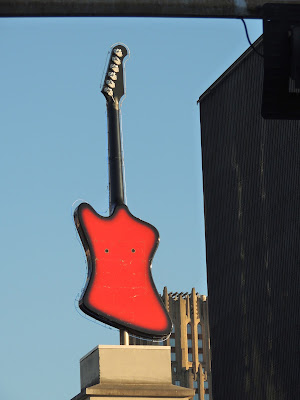 Red rotation guitar atop Hard Rock Cafe at Bayou Place