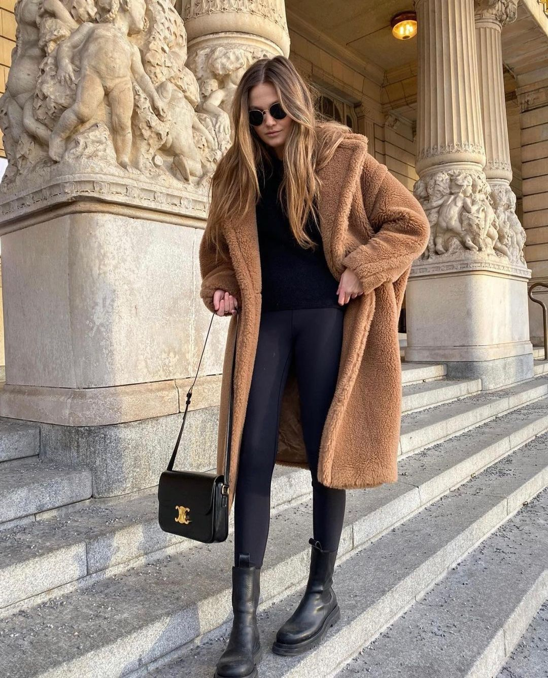 This Cozy Fall Outfit Is All I Want to Wear — @filippahagg in a camel teddy coat, black sweater, black leggings, and chunky lug-sole boots