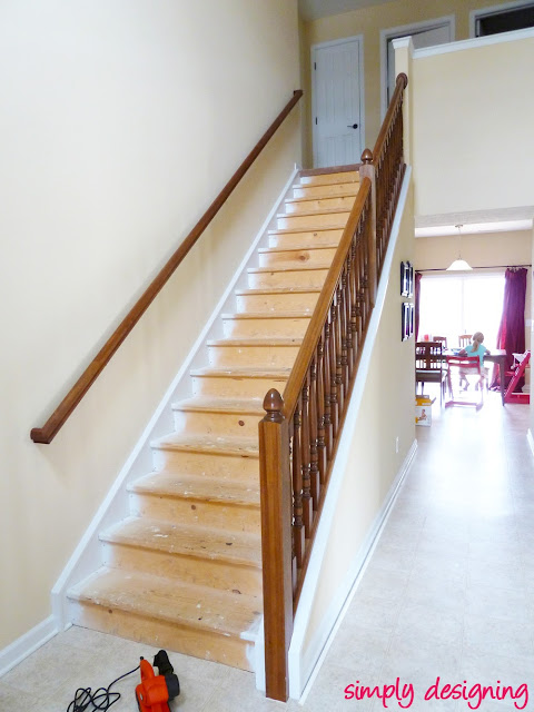 photo of staircase with all carpet and padding removed to show paint overspray on the stair treads