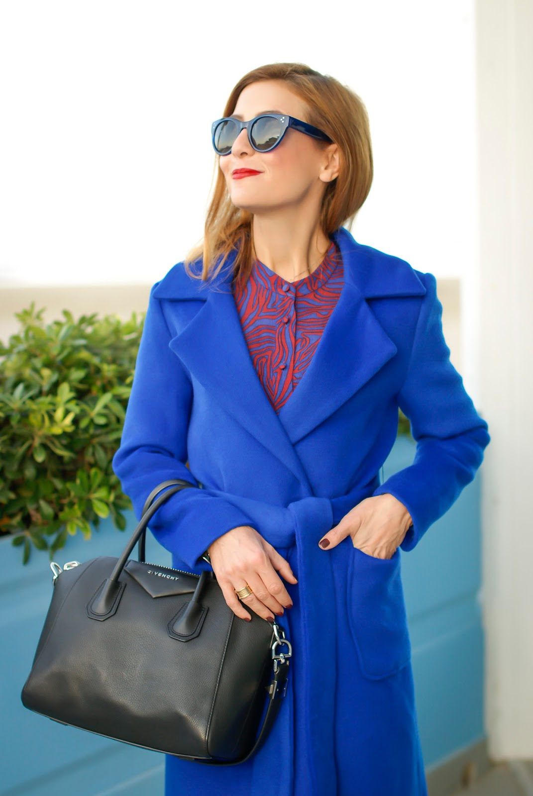 Royal blue belted wrap coat from Dezzal and Givenchy bag on Fashion and Cookies fashion blog, fashion blogger style