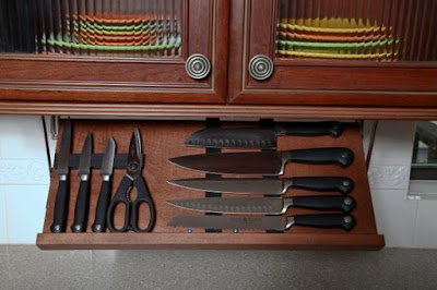 knife storage that installs under a kitchen cabinet; magnets hold the knives in place