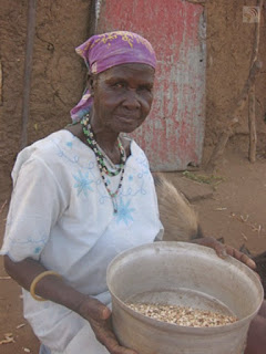May is sorting beans for dinner tonight in Kenya.