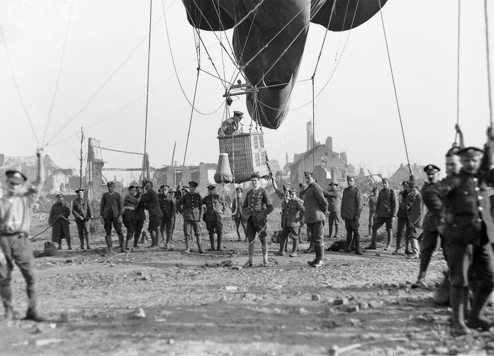 An officer prepares to ascend in an observation balloon near the ruins of Ypres, Belgium. 1917.
