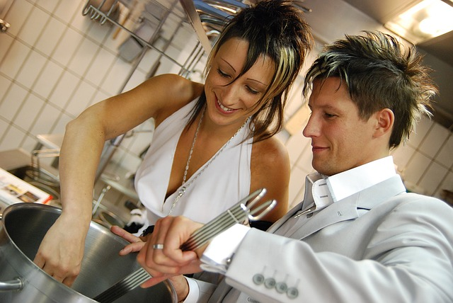 Man and Woman Cooking in the Kitchen