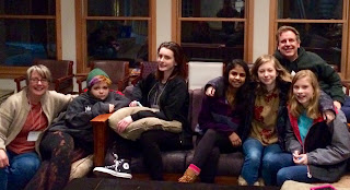 confirmands and adult leaders piled on couches at retreat center