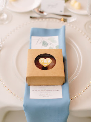 reception table setting blue decor and donut favor