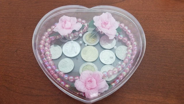 coins with pink pearls and flowers
