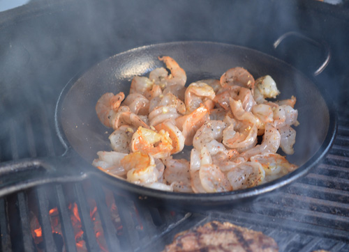 Butter and garlic shrimp sauteing in a Lodge ProLogic cast iron skillet