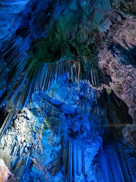 Blue lights illuminating the inside of St. Michael's cave.