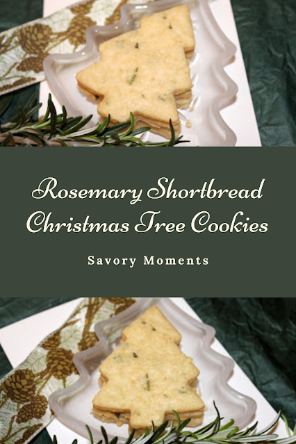 Baked rosemary shortbread Christmas tree shaped cookies sitting on a tree shaped plate with rosemary and a pinecone ribbon.