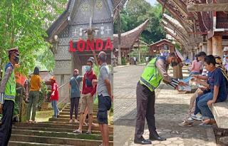 Satuan Lalu Lintas Polres Torut Bagi Bagi Masker di Wilayah Objek Wisata