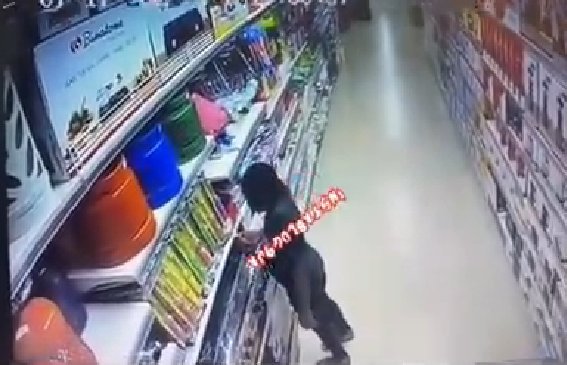 CCTV footage shows the moment a lady allegedly set a popular supermarket ablaze in Abuja
