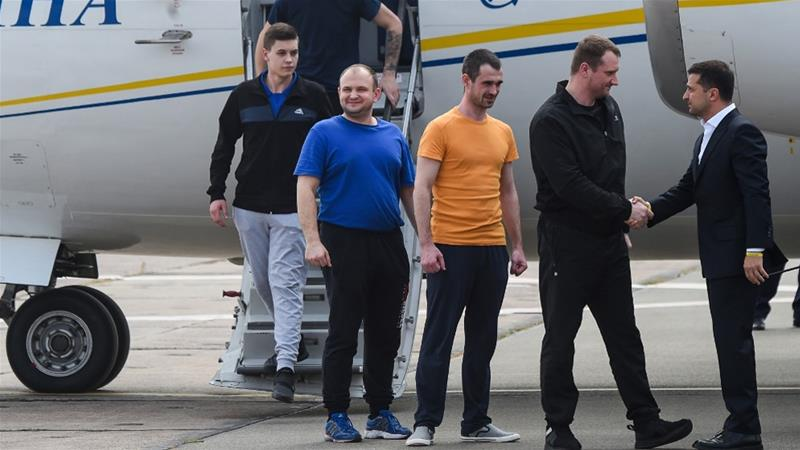 Ukraine's President Volodymyr Zelensky welcomes former prisoners as there arrive in Kiev
