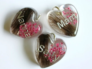 Personalised pendants containing preserved hair and flowers