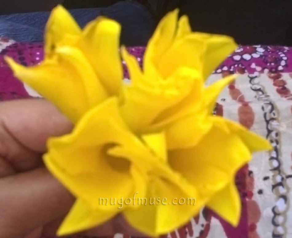 Happiness: It spreads with just one smile... and 4 yellow flowers