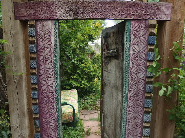 Ornamental doorway with a tempting glimpse of the garden beyond