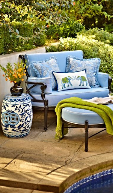 Gorgeous blue poolside chair and ottoman and Chinoiserie stool - found on Hello Lovely Studio